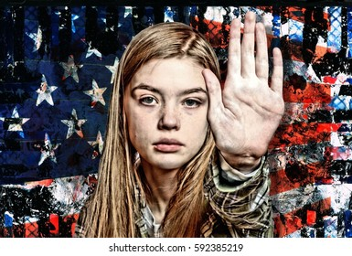 Beautiful Young Caucasian Model Motioning the Hand Sign for Stop in Front of a Grungy American Flag as a Symbol for Protest