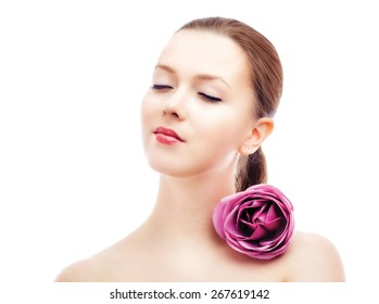beautiful young caucasian woman with naked shoulders and a rose, spa topic, isolated on white background