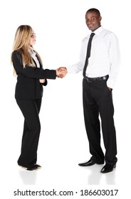 Beautiful young confident businesswomen wearing glasses and a black business suit with a white collar shirt and handsome black african businessman shaking hands and smiling.