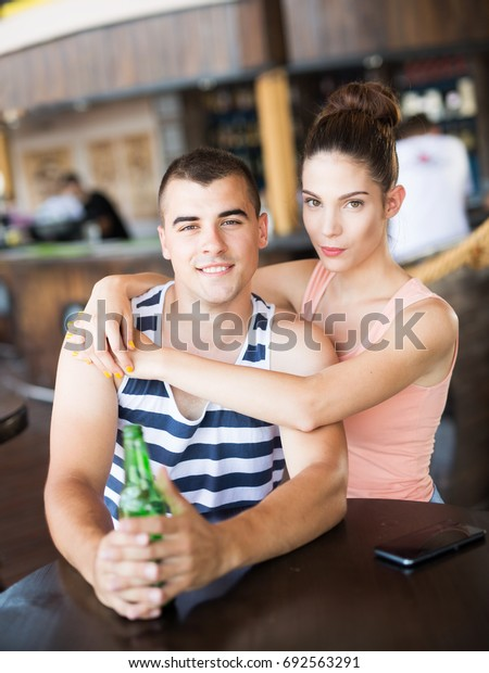 Beautiful young couple in cafe