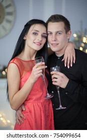 beautiful young couple celebrating christmas