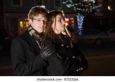 Beautiful young couple in city night. Shallow DOF