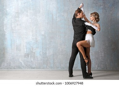 Beautiful young couple in dance studio