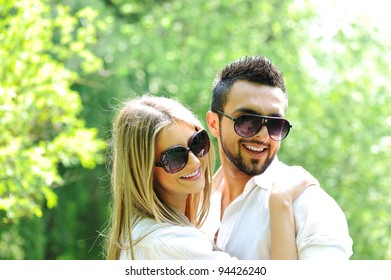 Beautiful young couple embracing in nature