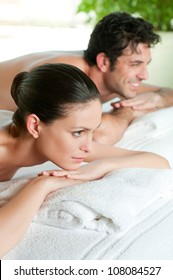 Beautiful young couple enjoy together a beauty treatment at spa