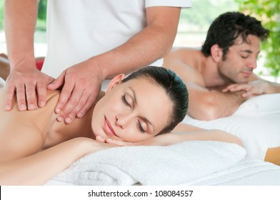 Beautiful young couple enjoy together a massage at spa centre