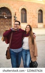 Beautiful young couple enjoying in shopping, walking and smiling.