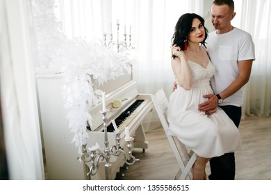 Beautiful young couple expecting a baby