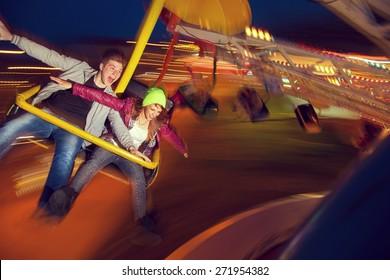 Beautiful, young couple having fun at an amusement park