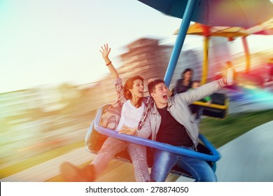 Beautiful, young couple having fun at an amusement park