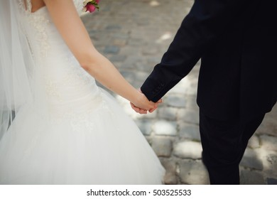 beautiful young couple holding hands