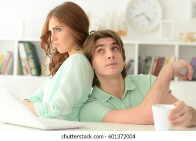 Beautiful young couple with a laptop