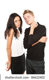 beautiful young couple looking at camera and smiling, isolated over white