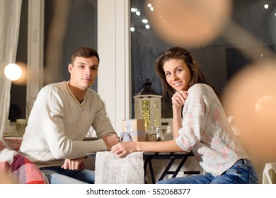 Beautiful young couple in love at Christmas