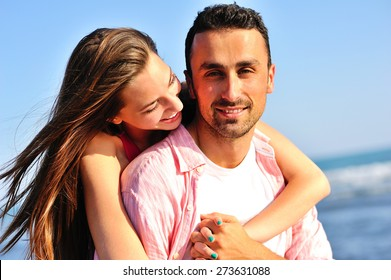 Beautiful young couple in love enjoying and having fun at the beach