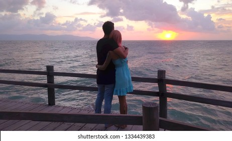 Beautiful Young Couple in Love Hug at Sunset time with Sea view