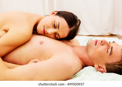 Beautiful young couple lying in bed.