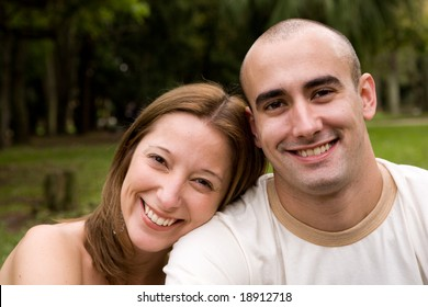 beautiful young couple on the park in sunny day