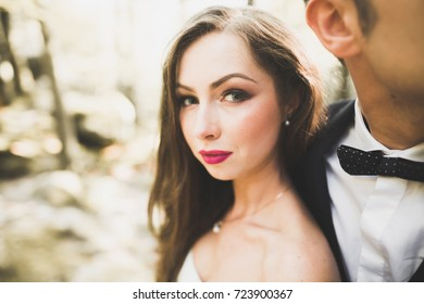 Beautiful young couple on their wedding day. Portraint close-up
