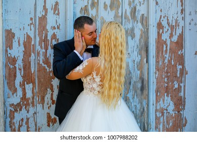 Beautiful young couple posing in front of old door