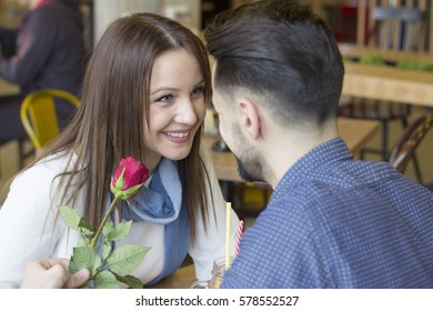 Beautiful young couple sitting at the table in cafe