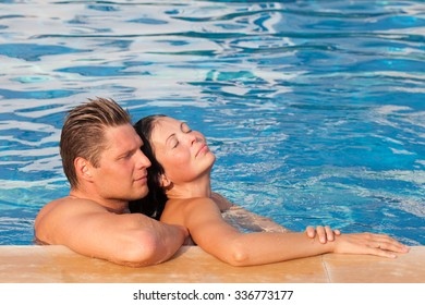 Beautiful young couple in a swimming pool