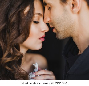beautiful young couple tenderly kissing