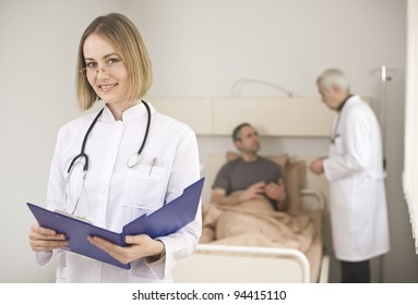 Beautiful young doctor with a clipboard