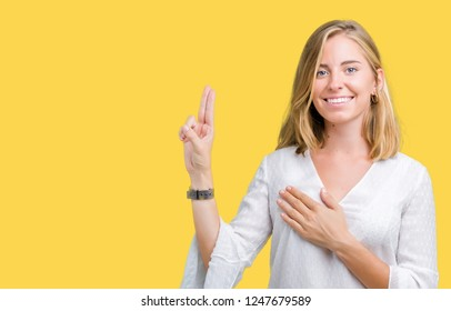 Beautiful young elegant woman over isolated background Swearing with hand on chest and fingers, making a loyalty promise oath