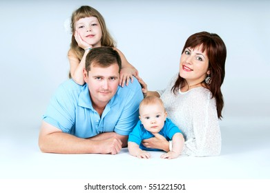 Beautiful young family with young children