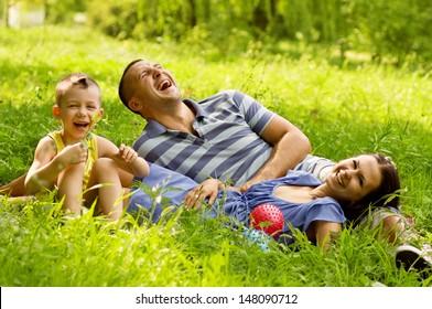 Beautiful young family having fun outdoors