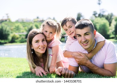 Beautiful young family having a good time at the park.