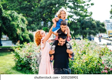 beautiful young family with ice cream walking on the street