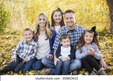 Beautiful Young Family Portrait with fall colors in the background