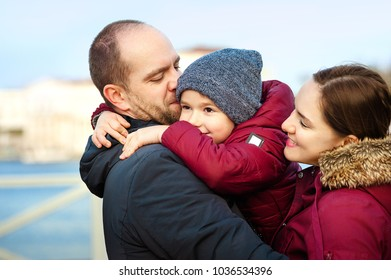 Beautiful Young Family Portrait on the quay near the sea