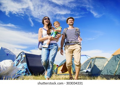 Beautiful young family at summer music festival
