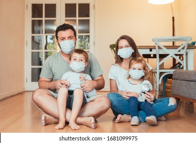 Beautiful young family wearing face masks against coronavirus world pandemic and staying home