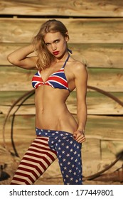 Beautiful young fashion model wearing red, white and blue clothing posing on sunny Arizona day.