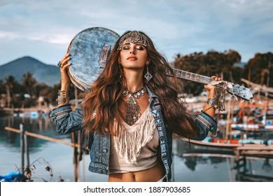 beautiful young fashion model woman posing outdoors at fisherman pier background