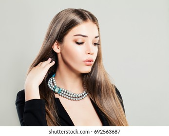 Beautiful Young Fashion Model Woman with Pearls Jewellery and Makeup on Banner Background