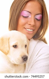 Beautiful young fashionable woman embracing her little dog