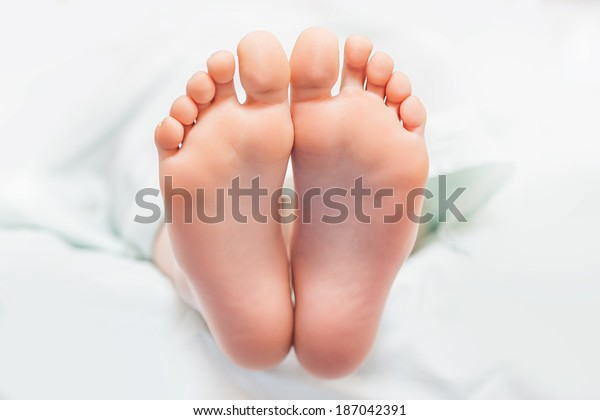 Beautiful young feet with body cream