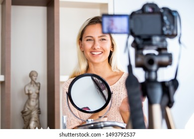 Beautiful young female blogger recording vlog video with makeup cosmetic at home online influencer on social media concept.live streaming viral