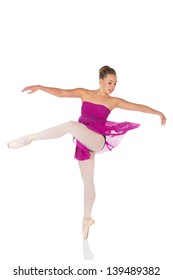 Beautiful young female classical ballet dancer on pointe shoes