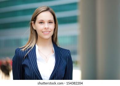 Beautiful young female executive in an urban setting