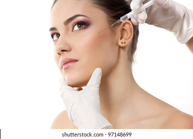 beautiful young female face and hands in gloves with beauty treatment injection isolated on white