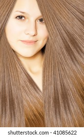 beautiful young female face with long beauty hair