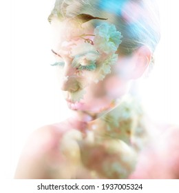 Beautiful young female face with spring blooming cherry tree flowers, double exposure. Beauty treatment, youth, springtime concept