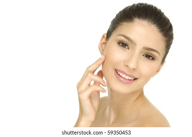 Beautiful young female face with a wellness complexion