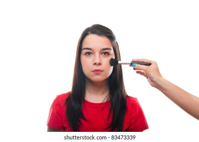 Beautiful young female getting her make-up done